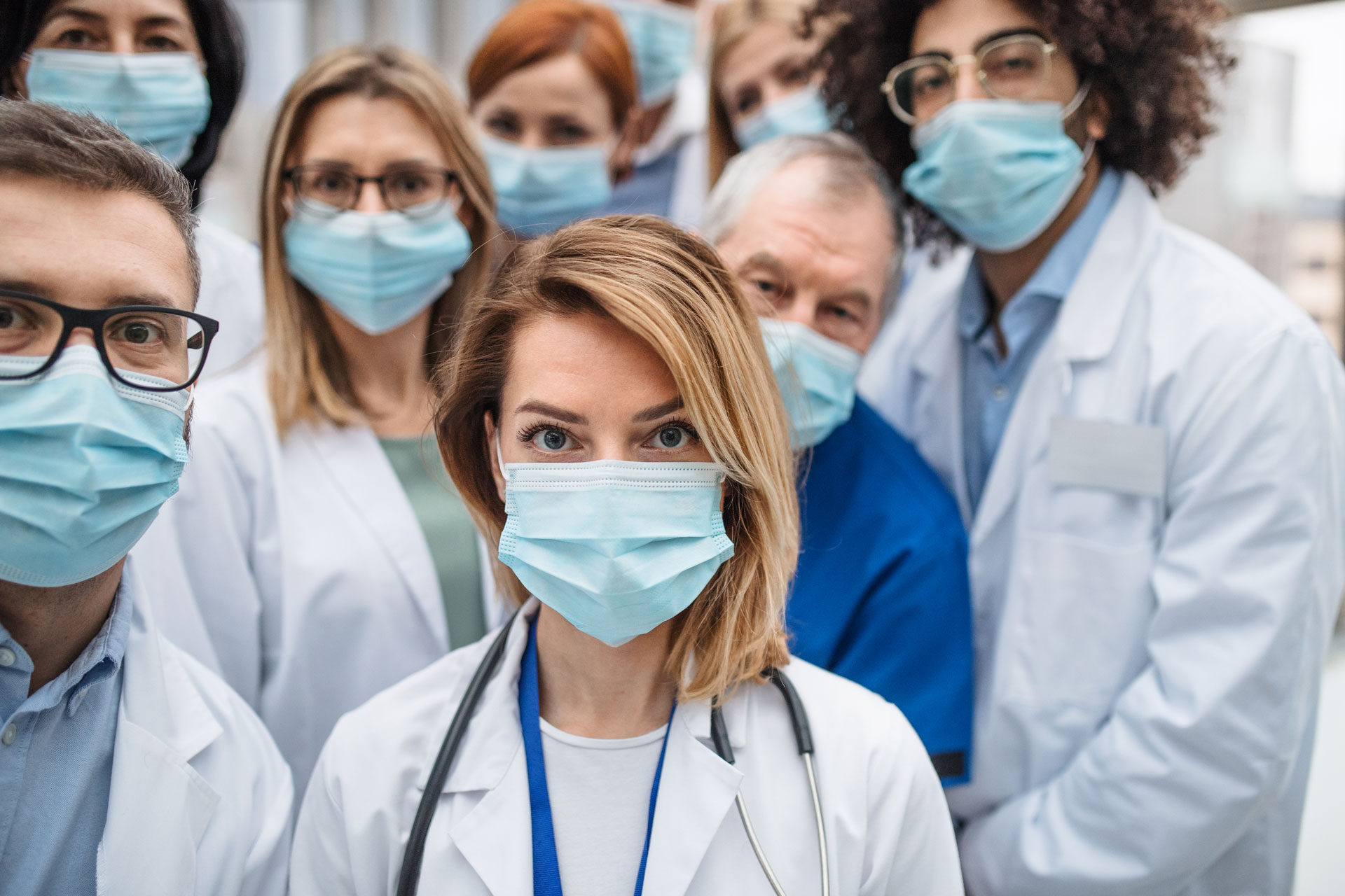 group-of-doctors-with-face-masks-looking-at-camera-ZAL8RZC.jpg